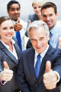 Successful-business-people-giving-you-a-thumbs-up-sign-000014379097_Small